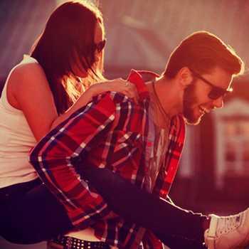 hipster couple piggyback