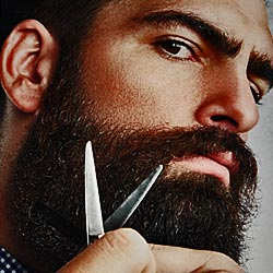 Manly Man trimming his beard