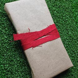 Paper present wrapped in fabric