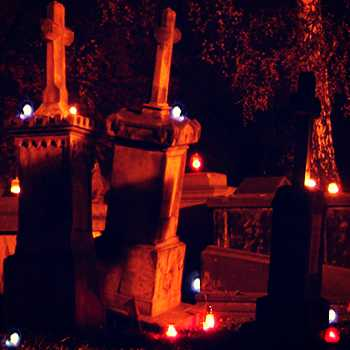 Picnic in cemetery with candles
