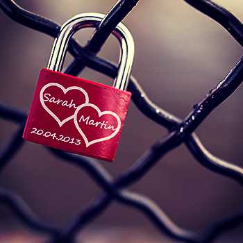 Red love padlock on fence