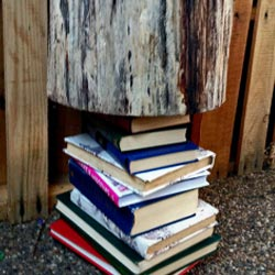 Flattening the books with a weight